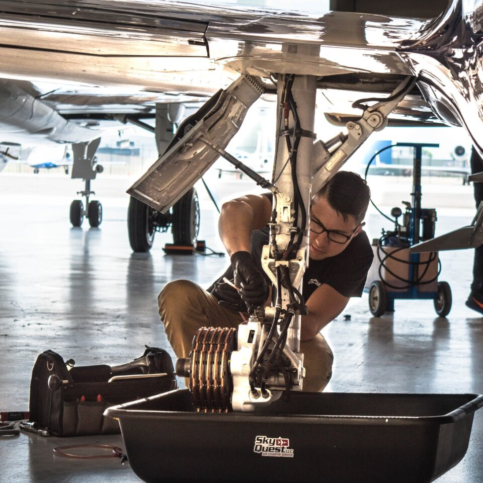 Airplane mechanic working on a landing gear