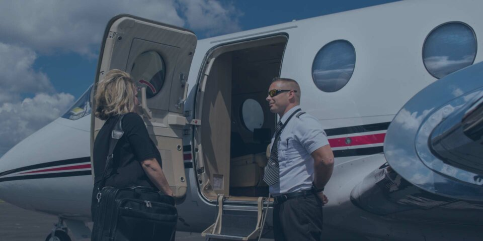 Pilot greeting passenger on private jet